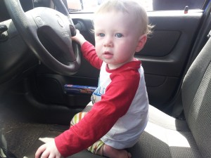 Josiah driving Grandma's car