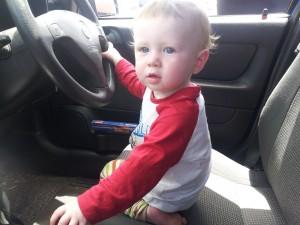 Josiah driving Grandma's car