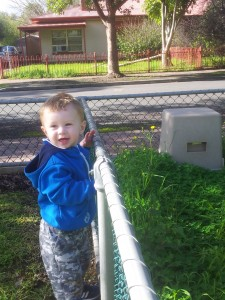 Josiah playing in the yard